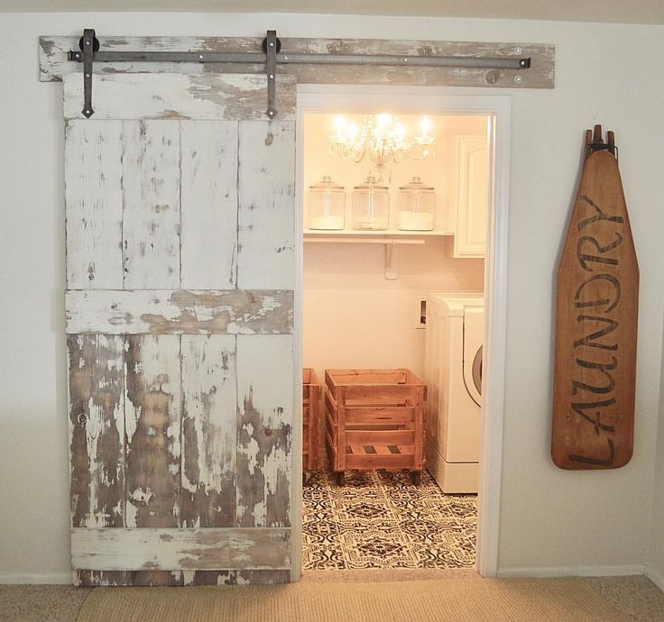 Laundry room with painted floor and barn door