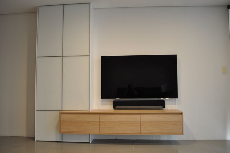 Stunning wall mounted entertainment unit we recently completed for a customer in Sydney! Featuring laminated timber grain floating unit with floor-to-ceiling glass doors framed in anodised aluminium! #zingfurniture #interiordesign #greatinteriors #wallmounted #entertainmentunit #sydney #australia