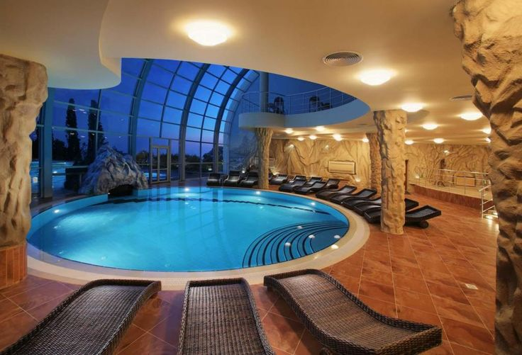 http://taizh.com/wp-content/uploads/2014/11/Adorable-round-pool-indoor-design-with-beautiful-lighting-design-and-sleeper-sofa-beside-poll-and-rattan-sleeper-sofa-on-brown-tile-floor-also-wide-glass-window.jpg