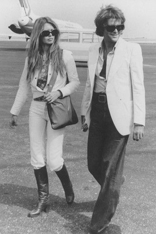 Brigitte Bardot and George Cibaud arriving in Nice in 1974. Could their ensembles be any more chic?