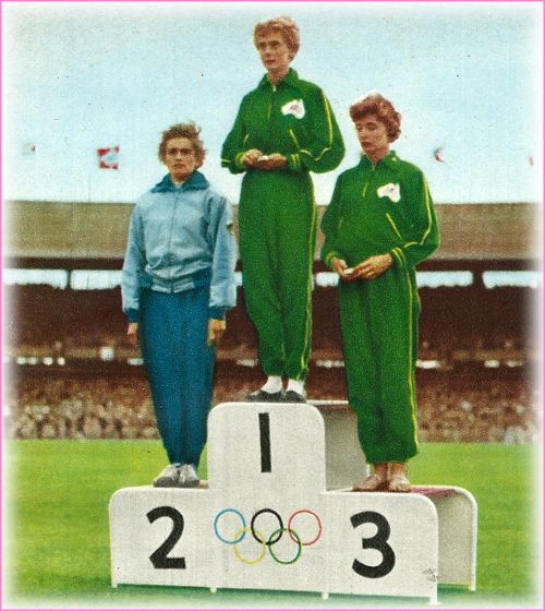 On the winner's podium: 100m Final. Australia's first gold medallist, Betty Cuthbert, with C. Stubnick (Germany) and Marlene Mathews (Australia)
