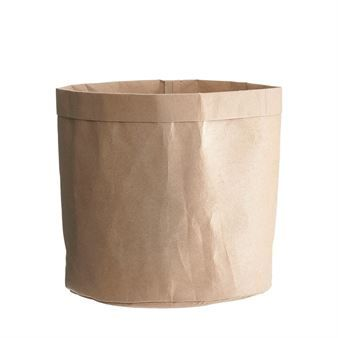 The Crafts storage bag is by the Danish design brand House Doctor. The bag is made of thick-sturdy paper and can be used for the storing magazines, your slippers or other knick-knacks that need a home. The simple design creates an effortless vibe to your interior. Available in different sizes.