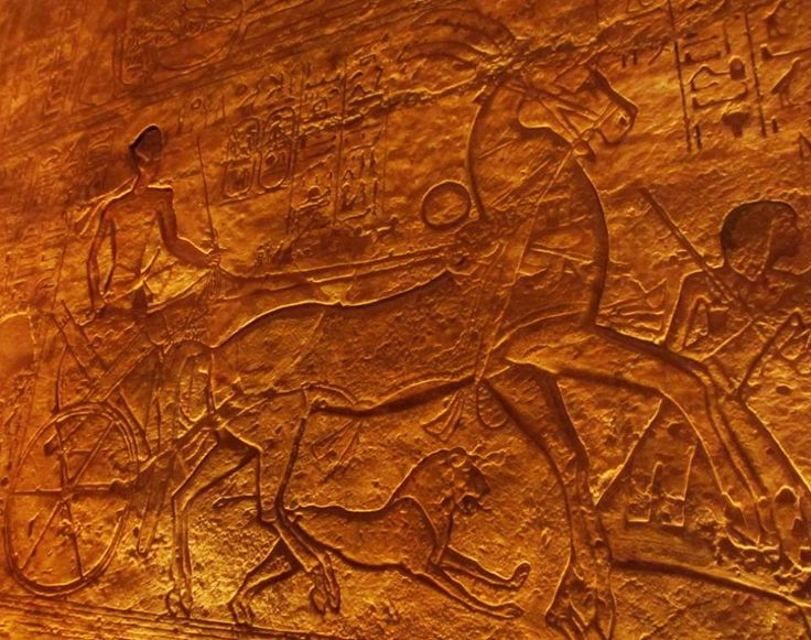 Scene showing Ramses II riding his chariot and accompanied by a lion into battle (Battle of Kadesh), Carving from his temple at Abu Simbel