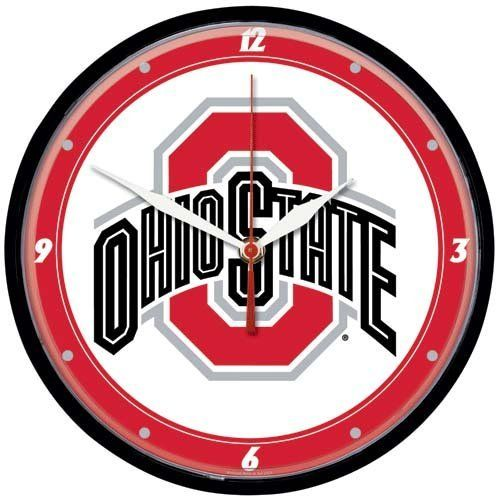 "Ohio State Buckeyes Round Wall Clock by WinCraft. $24.95. Quartz accurate movement. Great gift idea. Requires 1 AA battery, not included. Measures 12"" in diameter. It's always OSU game time when you keep track of your schedule and wait for their next victory with this round wall clock! Perfect for your dorm or fan cave, this circular clock features the team name and logo over a team colored background surrounded by a plastic frame for a classic, functional show of Buckeyes pride..."
