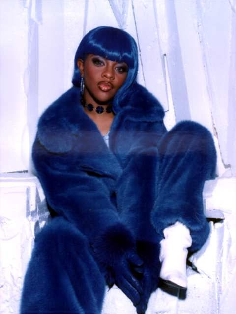 "Lil' Kim with the blue wig and blue fur, for the video ""Crush On You."""