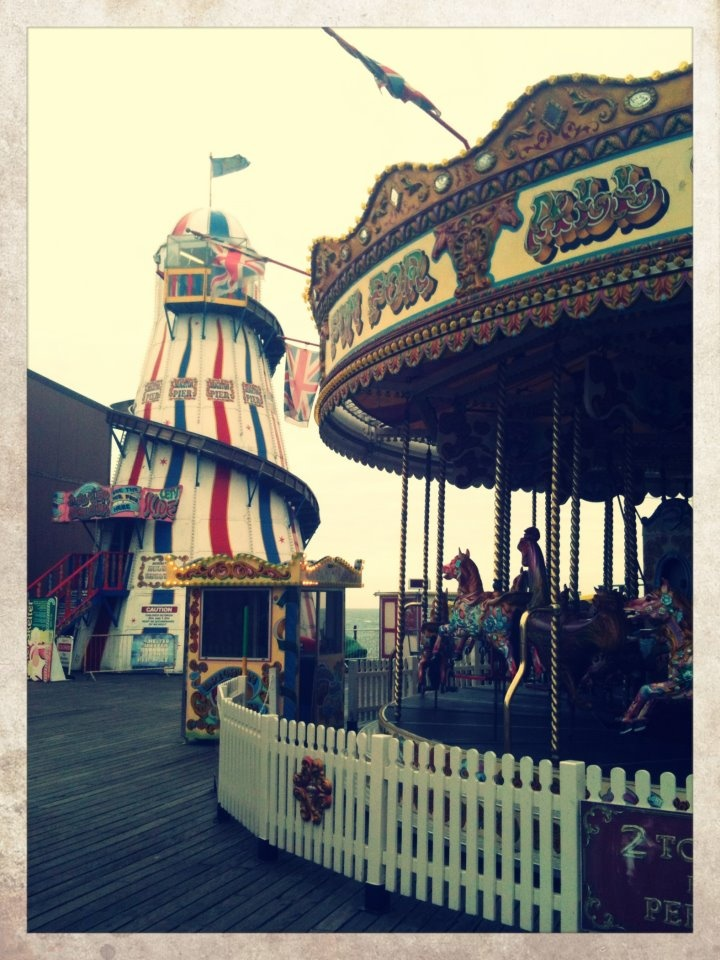 Fairground rides at Palace Pier, Brighton, UK