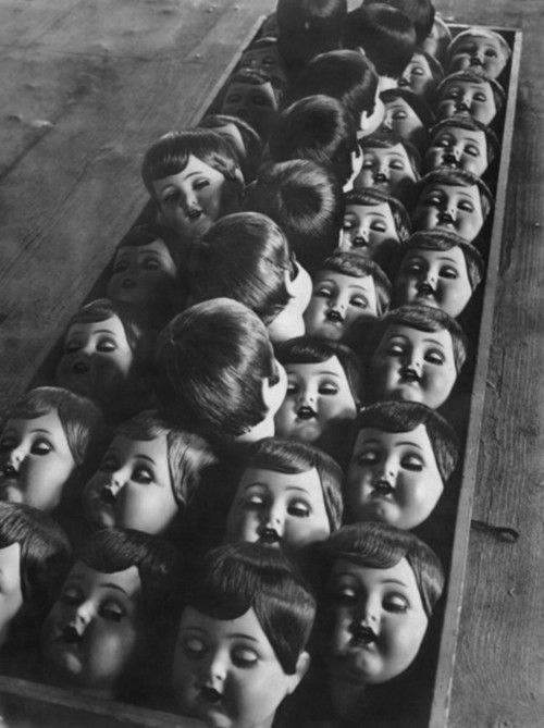 Doll production in Germany, 1950    Another of the disconcerting variety... nothing like a doll head en masse to give this girl a shiver... <3