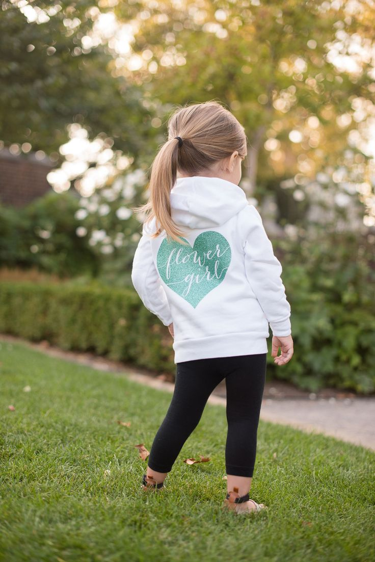 Flower girl and ring bearer hoodie that I can personalize for each girl and Jasper. It will come in handy for the evening chill.