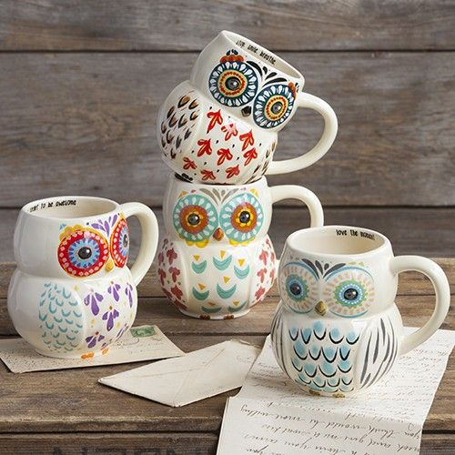 Whoooo doesnt love our owl mugs?? We sure do, so we made some in adorable folk art designs! Generous 16-ounce ceramic mugs in fun owl shapes, with brightly colored faces and feathers. Positive sentiments line the inside of each rim, and theyre dishwasher and microwave safe, making them the perfect everyday mugs!