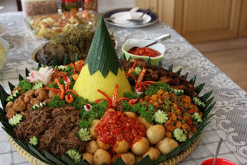 Nasi tumpeng, typical of indonesia consist of : yellow rice, balado eggs, empal (sweat meat), tofu, spicy tempeh,etc. Sometimes people in Indonesia make nasi tumpeng for celebration.