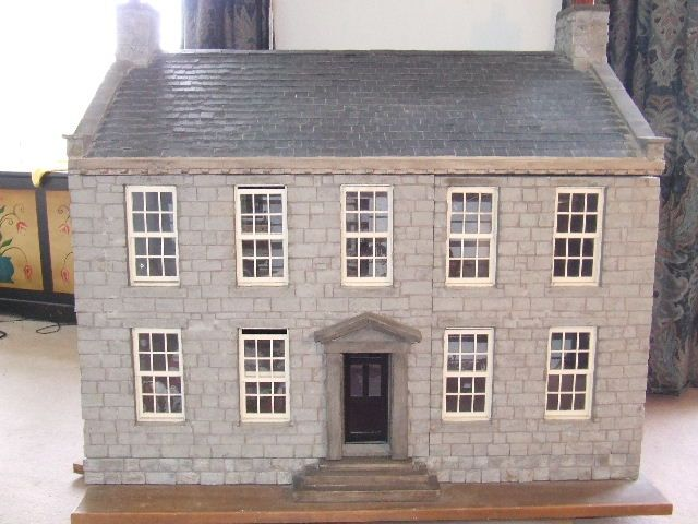 A Poldark Dollhouse Complete With Dolls Representing The