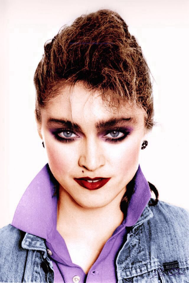 Madonna-Typical 80's makeup and popped collars