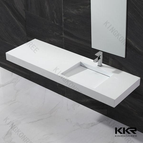 Foto de La pared colgó el lavabo de piedra de la resina de los fregaderos modernos del cuarto de baño en es.Made-in-China.com