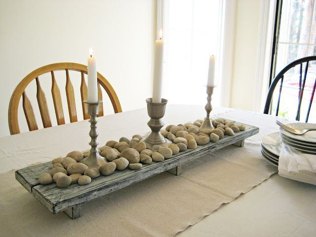 Lovely centerpiece using reclaimed wood and stones.  Love the idea of using all my collected Lake Superior stones.