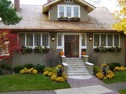 This is a great landscaping idea for a backyard patio with steps. Already gorgeous and picturesque in itself, it's really easy to add some of those smaller fall attributes to make the scene season ready. Not too many pumpkins here, but they are definitely there and add plenty of fall fun to the scene. The trees and plants incorporated in the scene add a variety of texture and color perfect for fall.