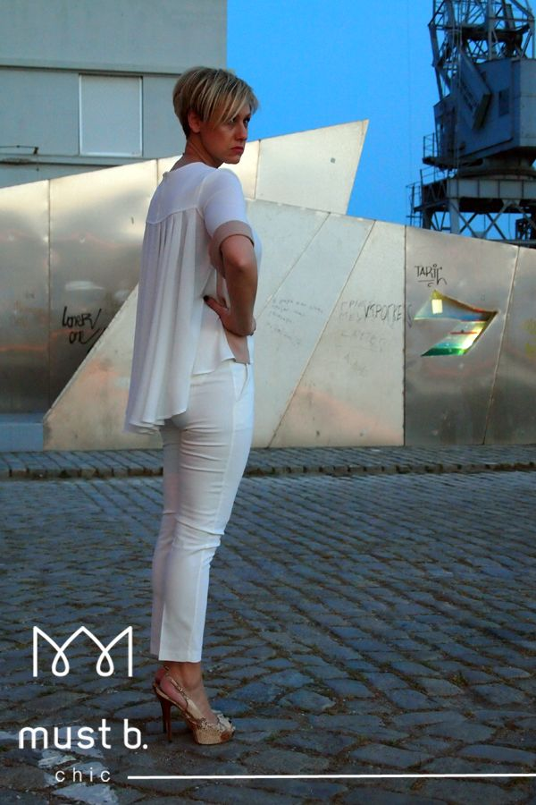 White trousers and fashionable white short sleeved blouse with beige details SS2015