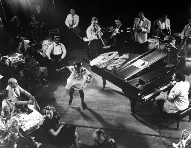 Pearl Primus performs to Honeysuckle Rose as played by an all-star group consisting of Teddy Wilson (piano), Lou McGarity (trombone), Sidney Catlett (drums), Bobby Hackett (trumpet) and John Simons (bass).