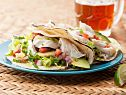 Easy Fish Taco Dinner  Marinade fish in lime juice, cut up jalapeno and put chili powder and avocado oil in bowl. Cook. Top cooked fish with cabbage, sour cream, onion and hot sauce.