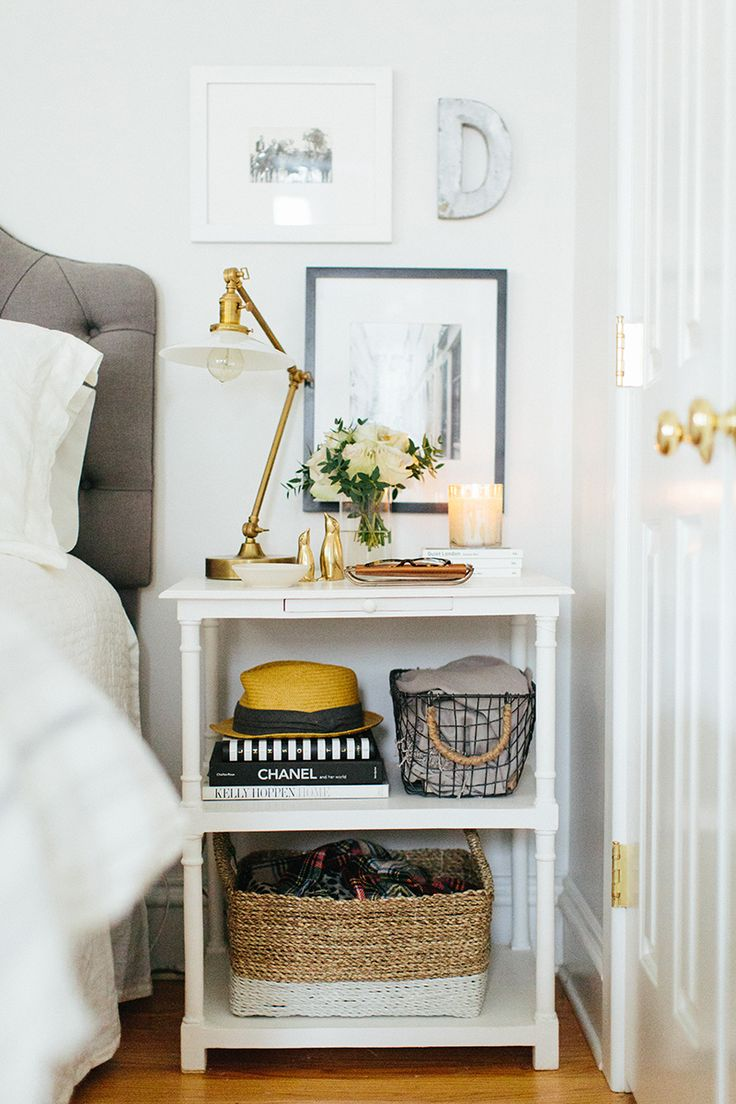 Storing accessories on you nightstand makes them easy to grab while you're getting dressed in the morning but also makes the styling feel polished yet unfussy. The key is to stash smaller items like scarves and jewelry into baskets or dishes to keep the look from feeling cluttered.: