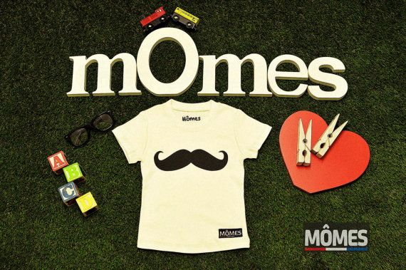 Mômes design 100 Certified Organic cotton kids boys \ $25.00. Big Moustache at the front with cyclist at the back.  All Our T-Shirts are 100% Certified Organic Cotton and are $25 each (FREE shipping included).  You can purchase this by: 1.Visiting Mômes' website: www.momes-store.com 2.Email - momes@momes-store.com 3.Message via Facebook (4 photos)
