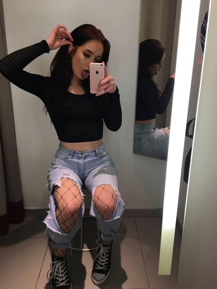 long sleeve black crop top + destroyed boyfriend jeans + fishnet leggings + converse