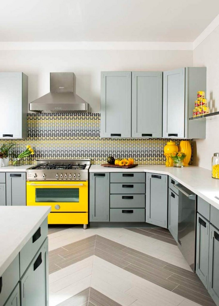 gray cabinets. yellow oven