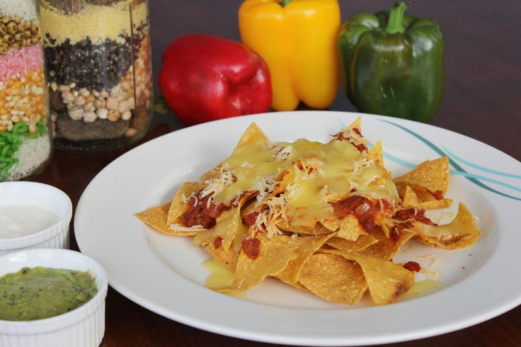 Nachos with Tomato Salsa is a tasty Mexican dish made with wheat and corn flour into crisp crackers served with guacamole sauce.