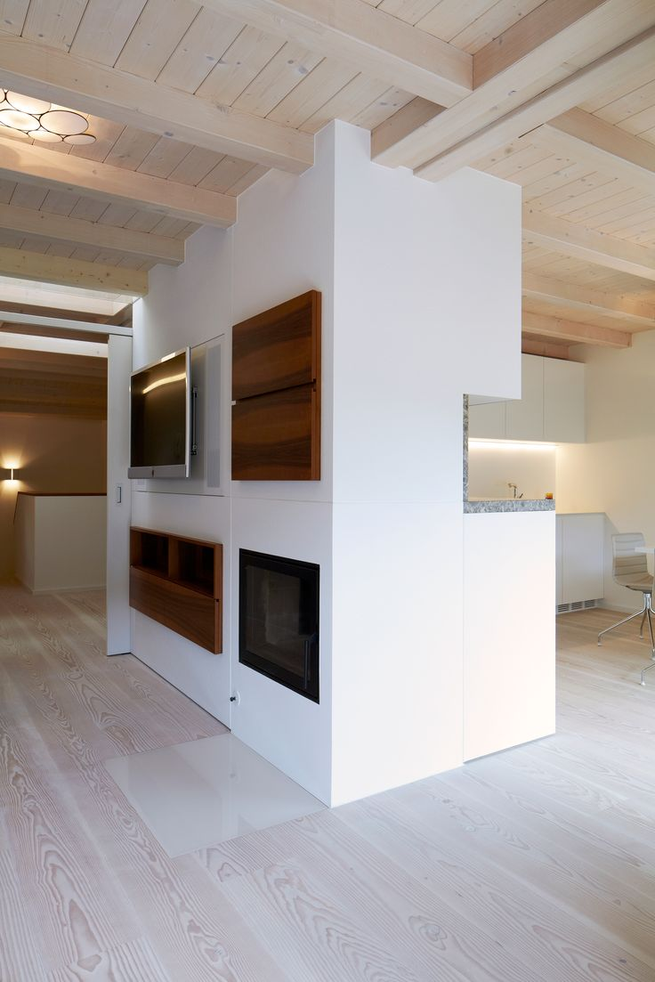 Vertical interventions in #darker #wood grain matched with #forms #white #contemporaryliving