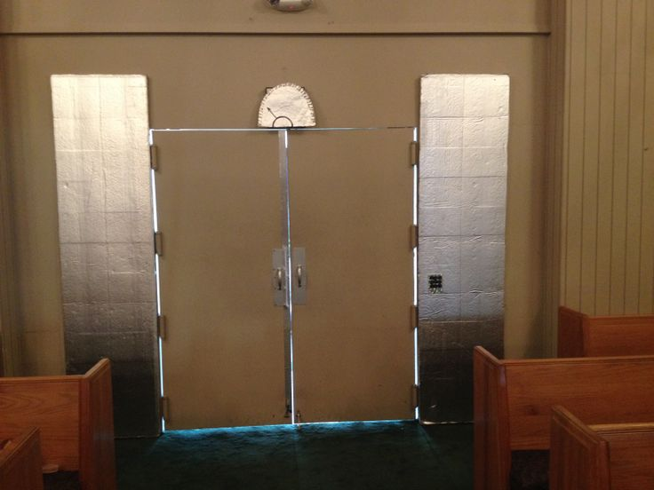 Elevator....at double doors at the rear of church