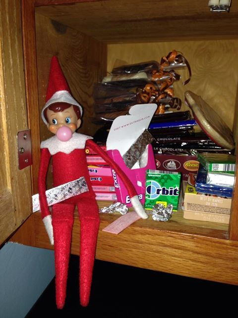 Elf on The Shelf chewing bubble gum and blowing bubbles!