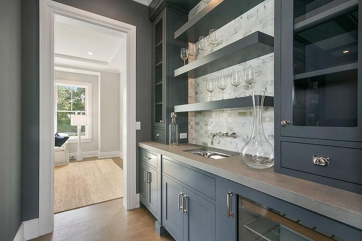 Gray Butler 39 S Pantry Is Fitted With Gray Cabinets Accented With Polished Nickel Pulls And A