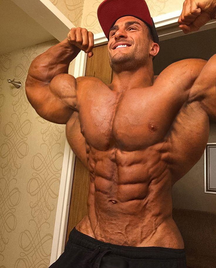 Muscle men flexing big biceps