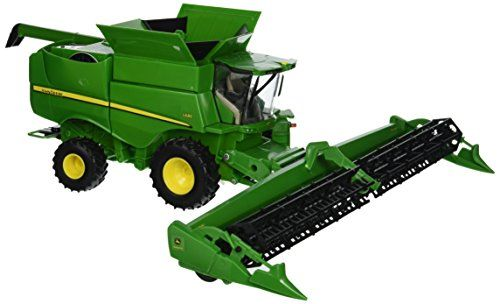 Big Farm S680 Combine Vehicle with Draper Head:   The TOMY 1:32 John Deere S680 Combine has exceptional detail. The draper (grain) head rotates when combine is pushed forward or backward. Other features include movable unloading auger, movable entry steps and steerable rear wheels. Exceptional detail for a collector and great play value for the carpet farmer. Age grade 3+ years.