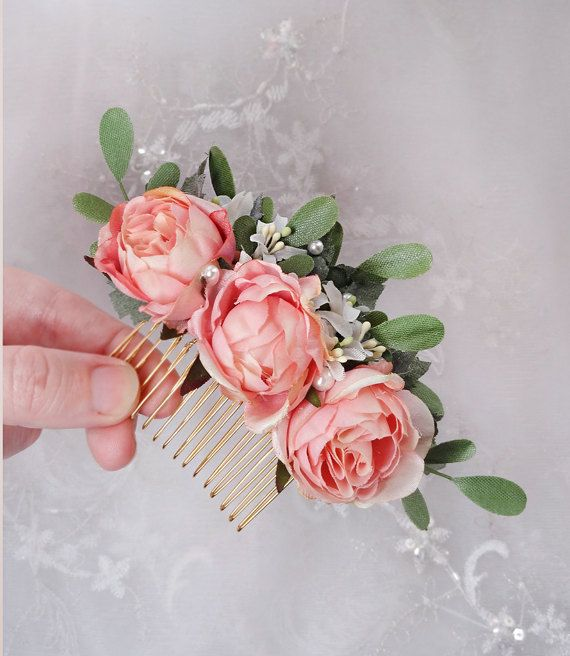 Darling hair comb made of petite pink roses against a spray of green leaves, with delicate white wildflower accents. Small pearls add a delicate special occasion feel. Chose a metal hair comb backing or hair clip. – SIZE: about 4 long – COLORS: light pink, green, white – ATTACHES: with a metal hair comb – MADE TO ORDER, ships in 1-2 weeks. Rush service also available. –––– SHIPPING / POLICIES –––– I ship world-wide. All items are carefully made to order, and are final sale. Please rev...