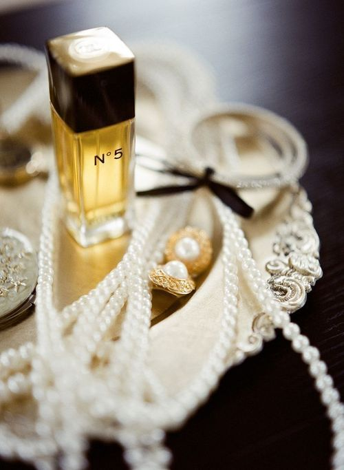 Perfume, pearls, silver and bows