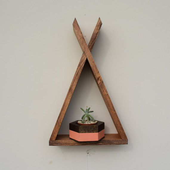 Roaming Roots teepee shelf is all you'll need to add a southwestern flair to your decor!  https://www.etsy.com/listing/249402268/brown-teepee-wood-floating-shelf-with-3