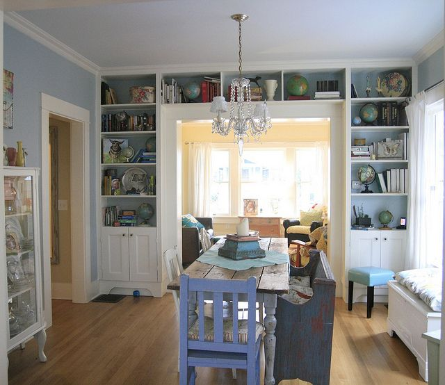 dining room. remodeled. bright. light. 1926 portland, oregon bungalow. bookshelves around doorway = best idea ever.