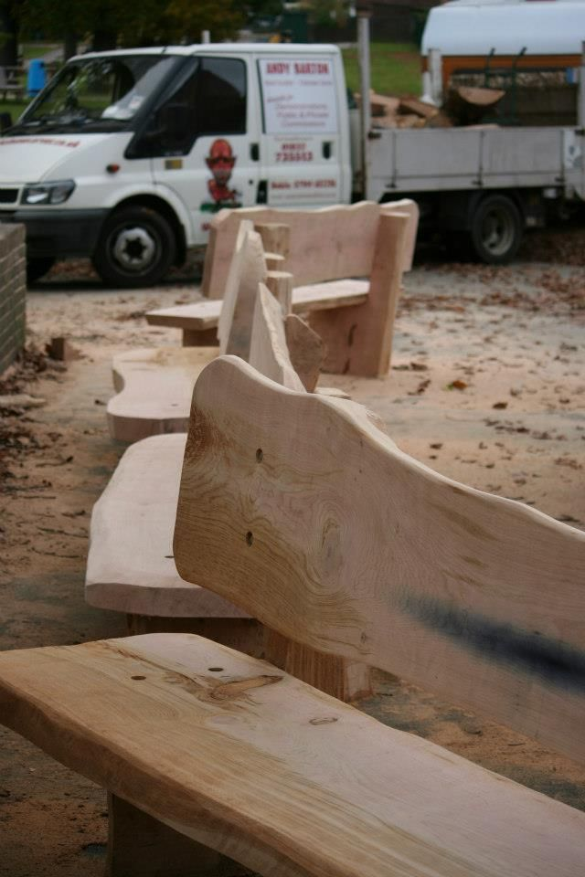 Oak benches before they were oiled chainsaw carved