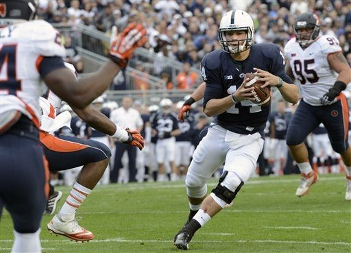 PENN STATE – FOOTBALL 2013 – Penn State quarterback Christian Hackenberg (14) scores on a 9-yard run in the second quarter of an NCAA college football game against Illinois in State College, Pa., Saturday, Nov. 2, 2013. (AP Photo/John Beale)