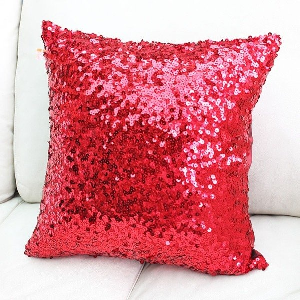sparkly red pillow....amidst all of the beige....♥