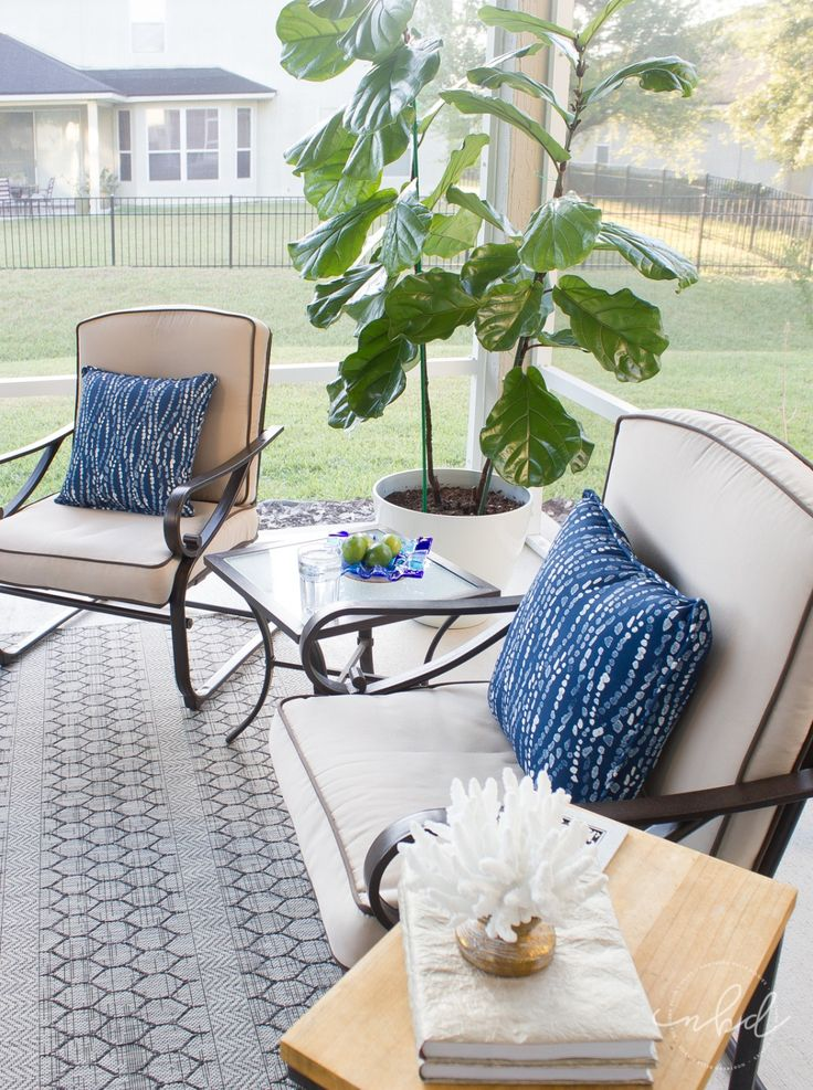 An outdoor oasis courtesy of Northern Belle Diaries. Infuse your style and personality into your patio or deck with colorful, patterned accessories. A cozy fire table is the icing on top of this makeover.