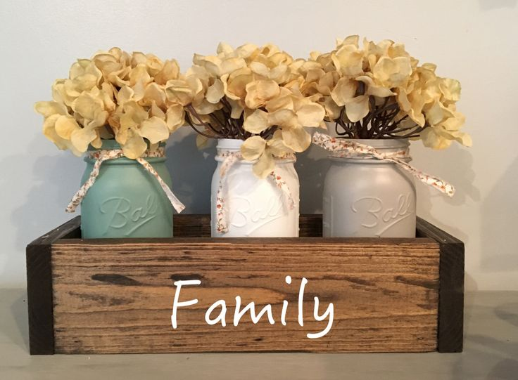 """The wooden planter box measures 13.5 x 5 x3.5"""" and fits 3 pint size mason jars which have been painted serenity blue, blossom white and light gray."""