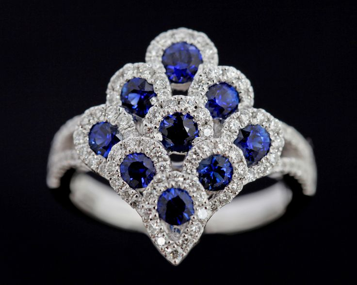 The Peacock ring.  An array of stunning Sapphires and Diamonds in 18 carat white gold