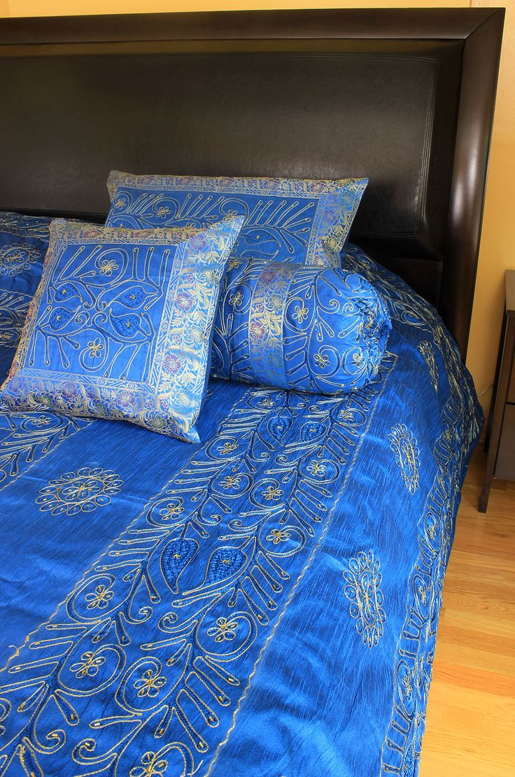 Ornamental blue 7-Piece #duvet cover set. Beautiful and elegant Indian bedding set features embroidery and beads in a soft dupioni satin fabric. Click to shop @ Banarsi Designs!
