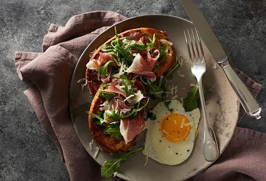 French toast doesn't always have to be sweet. With parmesan, Bayonne ham, and eggs, this savory toast is perfect for brunch.
