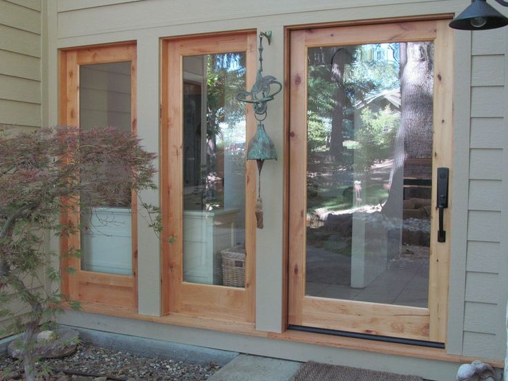 The raw wood finish of the frames on these ETO doors give it a summery lake & Best 25+ Eto doors ideas on Pinterest | Entry doors Home ... pezcame.com