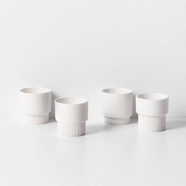Ferm Living's espresso cup is perfect for your coffee boost. Crafted from lightweight matte porcelain with decorative grooves at alternating heights, this stackable cup is offered as a set of four that fits seamlessly into every tableware setting. Colour: White Size: H: 5.5 x W: 5.5 cm Material: Porcelain Care instructions: Dishwasher safe