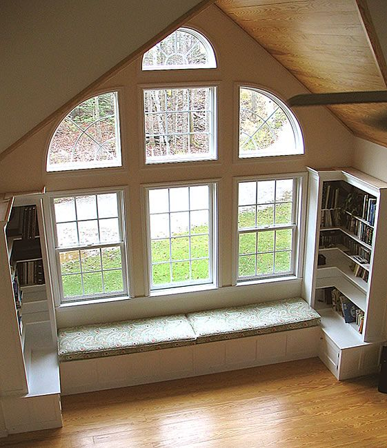 this window seat with the built-ins curving around the corner- or push ends together for reading nook in family room