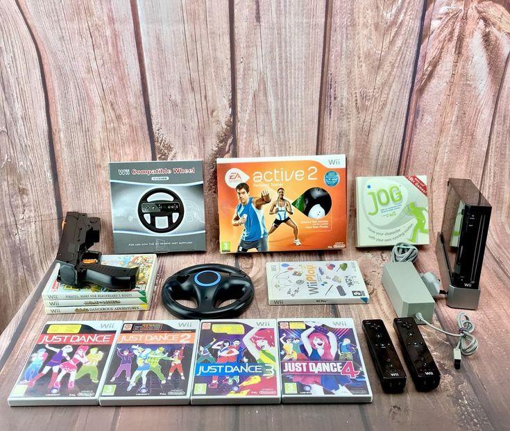Nintendo Wii console Bundle Sports Shooter Mini Games Just Dance 1 2 3 4 Wheels
