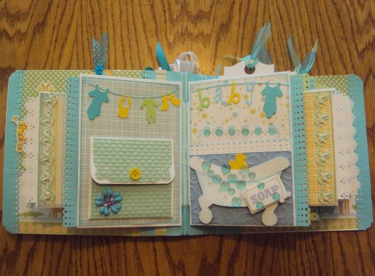 """album made by using a tutorial by Laura from """"Follow the Paper Trail"""". It is basically made from envelopes and then has a lot of side and end tags for large photos."""